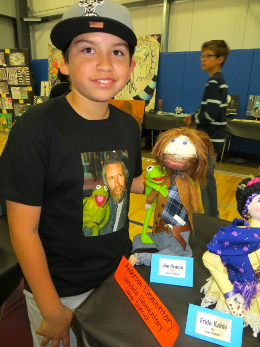 Student from Anderson Elementary presenting his artwork at the Student Art Gallery Exhibit