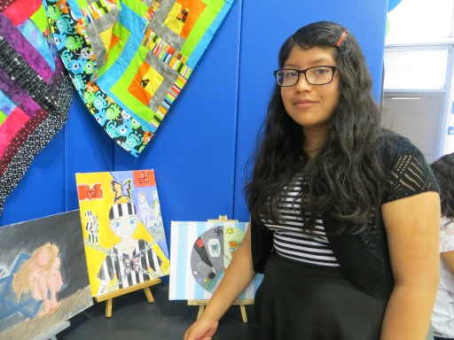 Student presenting her artwork at the Student Art Gallery Exhibit