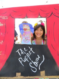 Puppet show performance conducted by an elementary school student